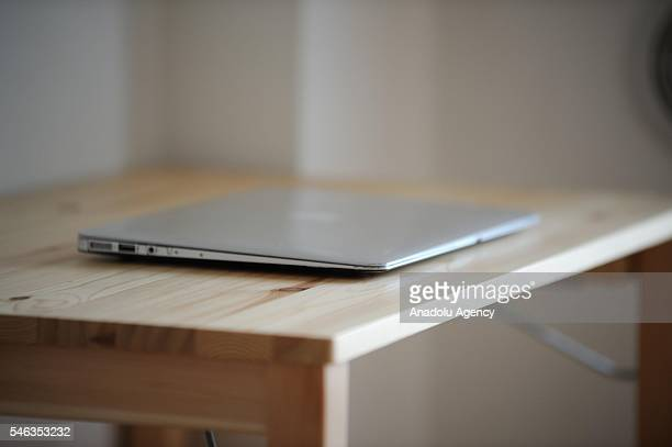 A laptop is seen on a table in the apartment of minimalist Fumio Sasaki in Tokyo Japan on June 24 2016 Fumio Sasaki Editor decided to live less...