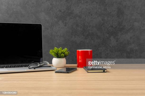 laptop, notebook, mobile phone and red coffee mug on office desk - good condition stock pictures, royalty-free photos & images