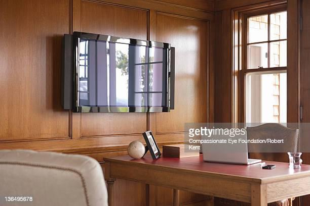Laptop on desk in home office