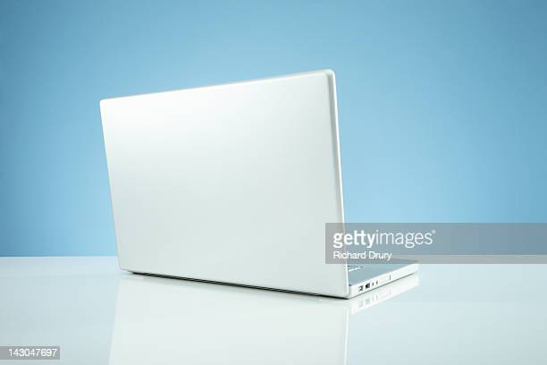 laptop on desk - richard drury stock pictures, royalty-free photos & images