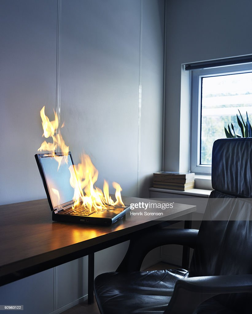 laptop office desk. Laptop On Fire At Desk In Office : Stock Photo G