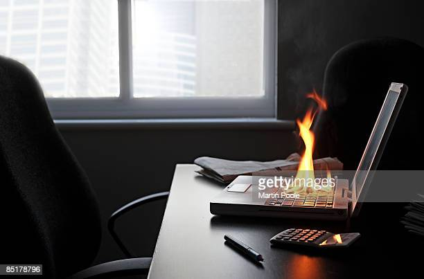 laptop on fire in office