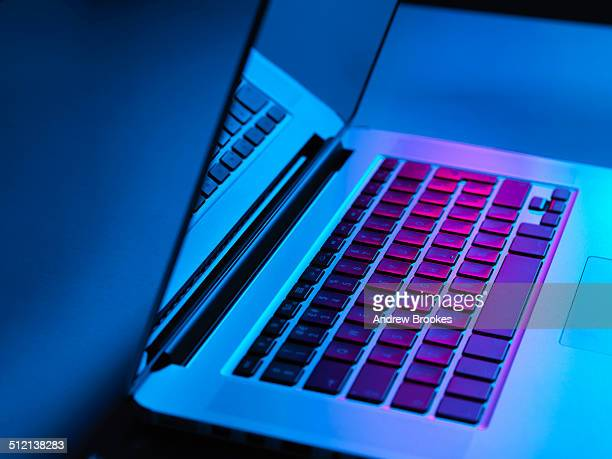 Laptop on office desk at night