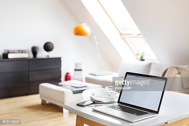 Laptop on table in a flat