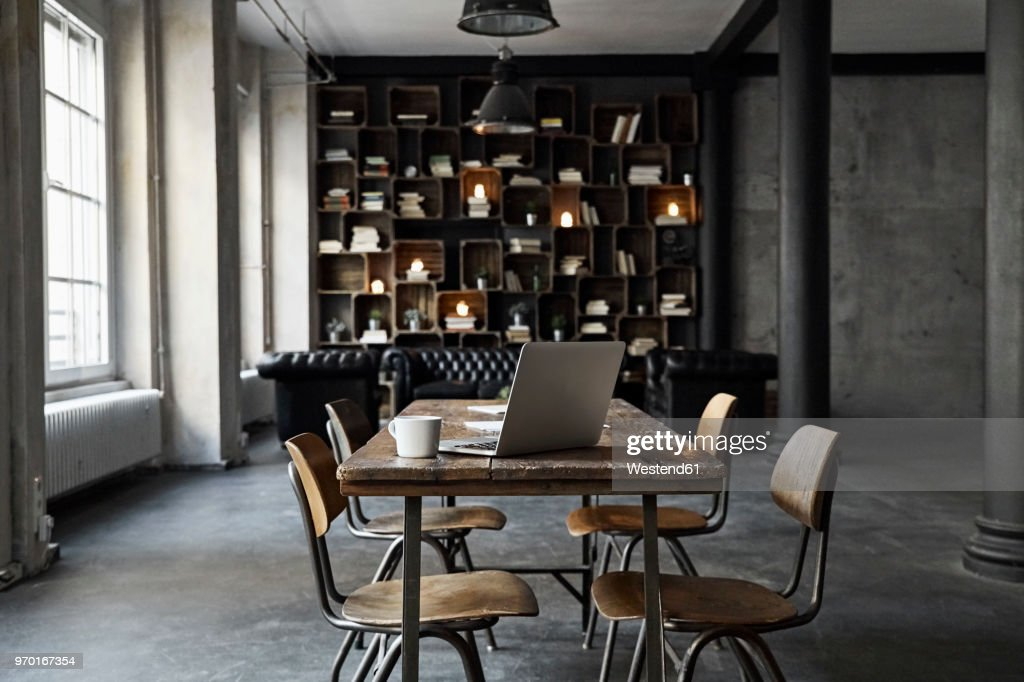 Laptop on table in loft : Stock Photo