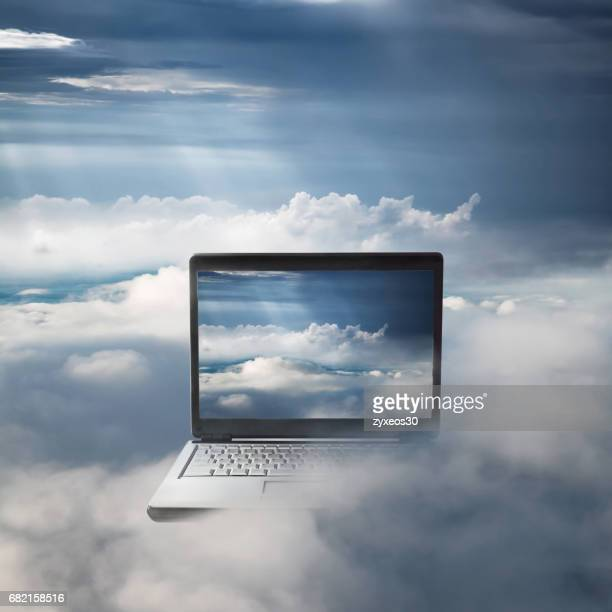 laptop on the clouds,The concept of cloud computing,futuristic.