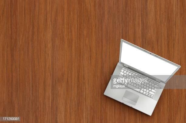 Laptop on Wooden Floor