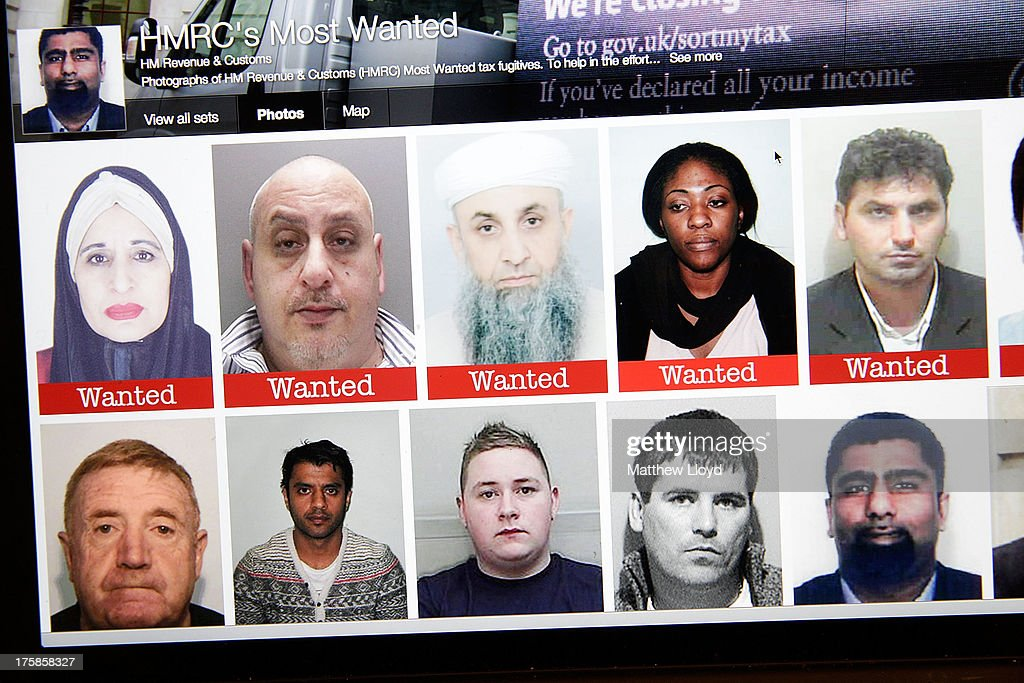 A laptop screen showing the HMRC Flickr feed, showing the faces of their most wanted tax evaders on August 9, 2013 in London, United Kingdom. So far only one of the original 20 published individuals has been apprehended.