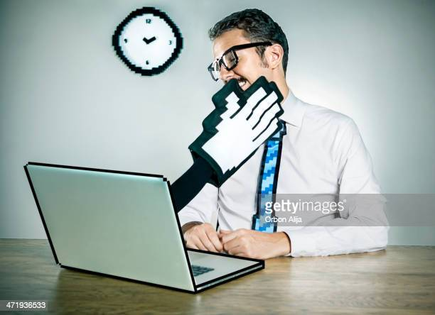 laptop slapping a businessman - slapping stock pictures, royalty-free photos & images