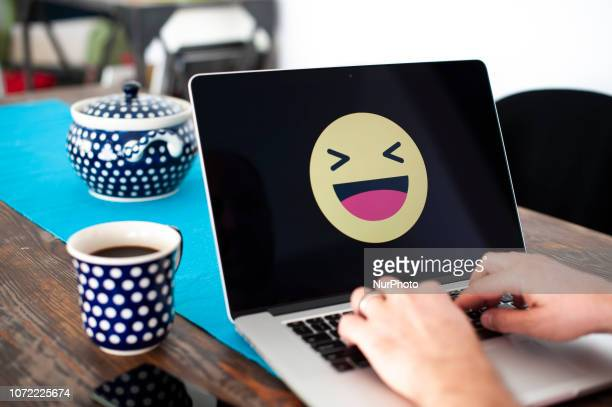 A laptop with a happy emoji face displayed is seen in this photo illustration on October 15 2018 in Warsaw Poland