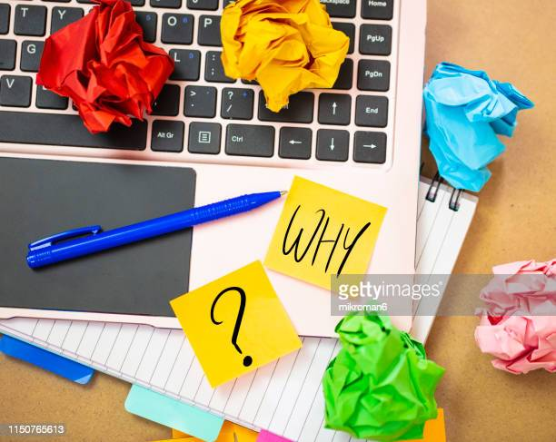 laptop with a note with why? - energy efficient lightbulb stock pictures, royalty-free photos & images