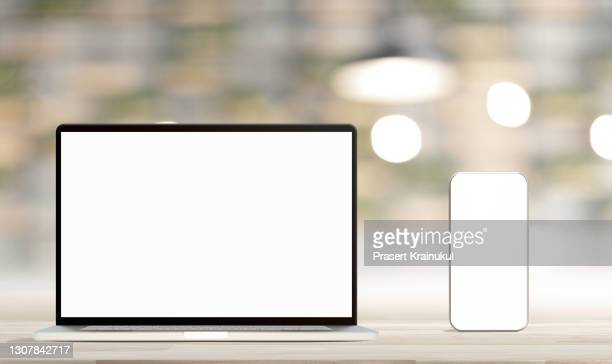 laptop with blank screen and smartphone on table. mockup - microsoft stock pictures, royalty-free photos & images