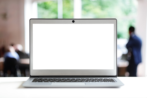 Laptop with blank screen in office 963149474