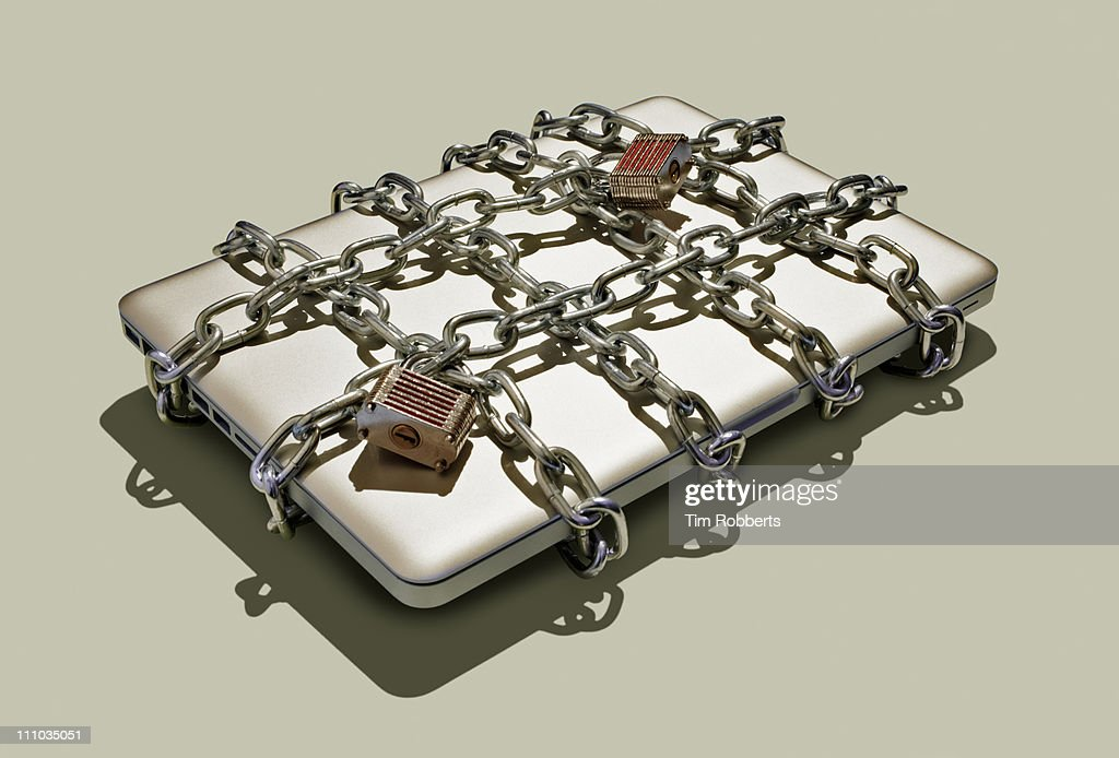 Laptop with chains and padlocks. : Stock Photo