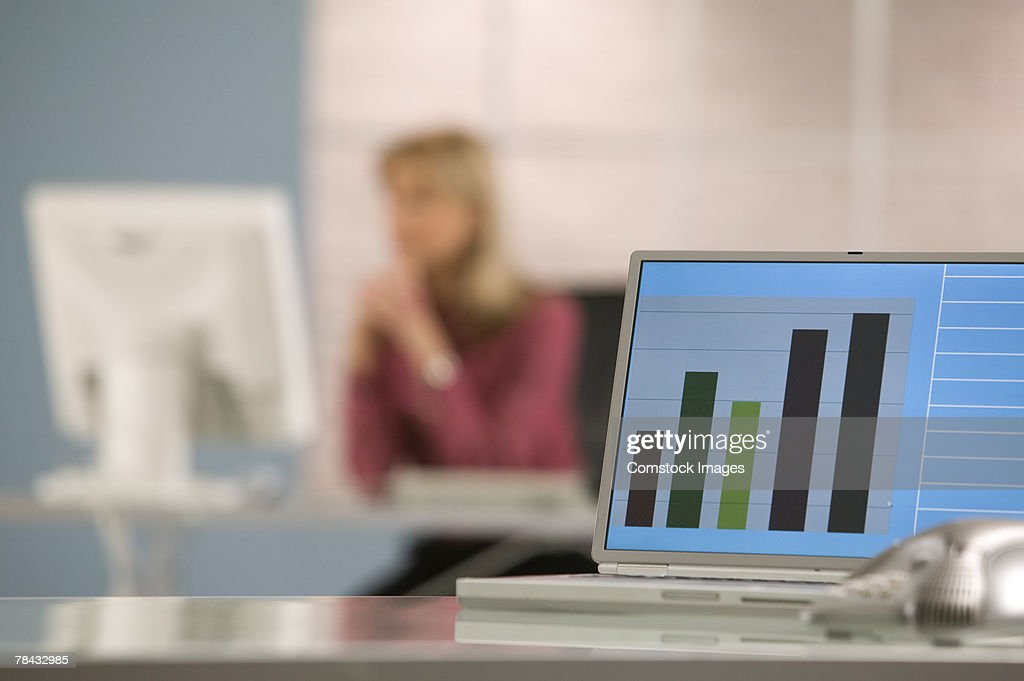 Laptop with graphs : Stockfoto
