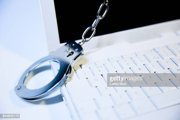 laptop with handcuff