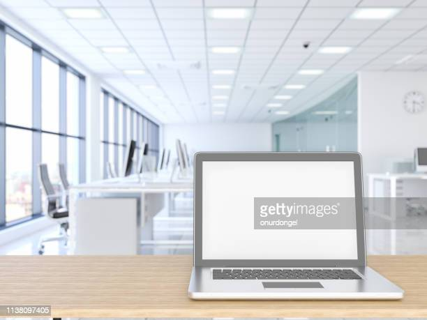laptop with wood empty surface and office building as background - laptop mockup stock photos and pictures