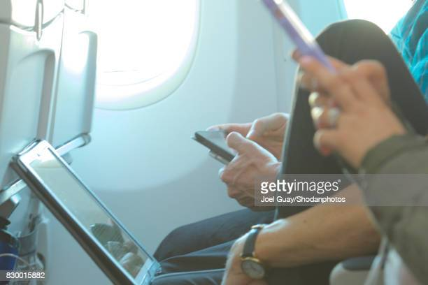 laptops and smartphones in airplane seat