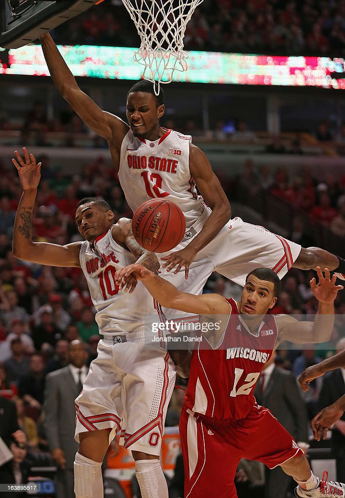 LaQuinton Ross #10 and Sam Thompson #12 of the Ohio State Buckeyes and Traevon Jackson #12 of the Wisconsin Badgers collide while going after a rebound during the Big Ten Basketball Tournament Championship game at United Center on March 17, 2013 in Chicago, Illinois. Ohio State defeats Wisconsin 50-43.