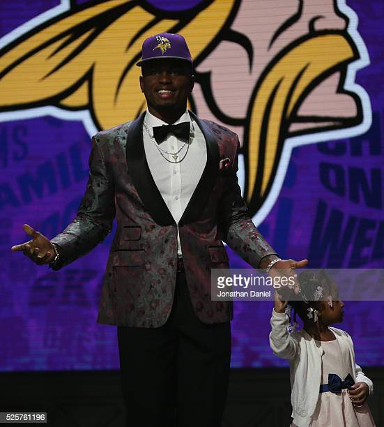 Laquon Treadwell of Ole Miss walks out with his daughter Madison after being picked overall by the Minnesota Vikings during the first round of the...