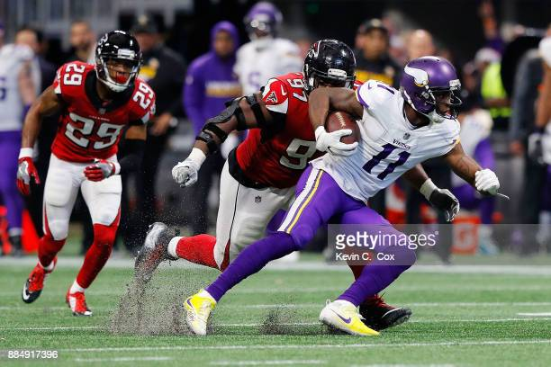 Laquon Treadwell of the Minnesota Vikings is tackled by Grady Jarrett of the Atlanta Falcons during the second half at MercedesBenz Stadium on...