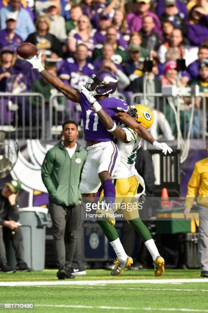 Laquon Treadwell of the Minnesota Vikings makes a one handed catch over Kentrell Brice of the Green Bay Packers during the third quarter of the game...