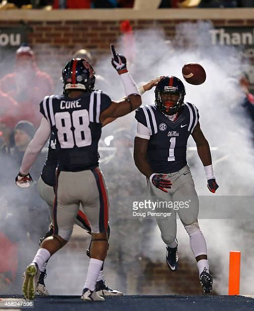 Laquon Treadwell of the Mississippi Rebels celebrtaes his 10 yard touchdown reception with Cody Core of the Mississippi Rebels to take a 147 lead...