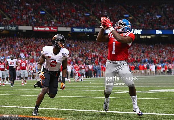 Laquon Treadwell of the Mississippi Rebels scores a touchdown against the Oklahoma State Cowboys during the fourth quarter of the Allstate Sugar Bowl...