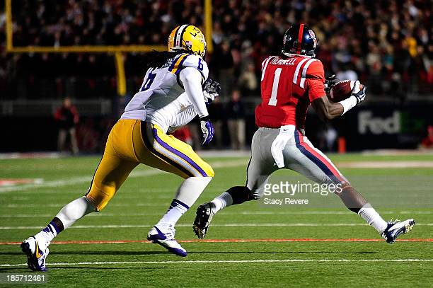 Laquon Treadwell of the Ole Miss Rebels catches a pass in front of Craig Loston of the LSU Tigers during a game at VaughtHemingway Stadium on October...