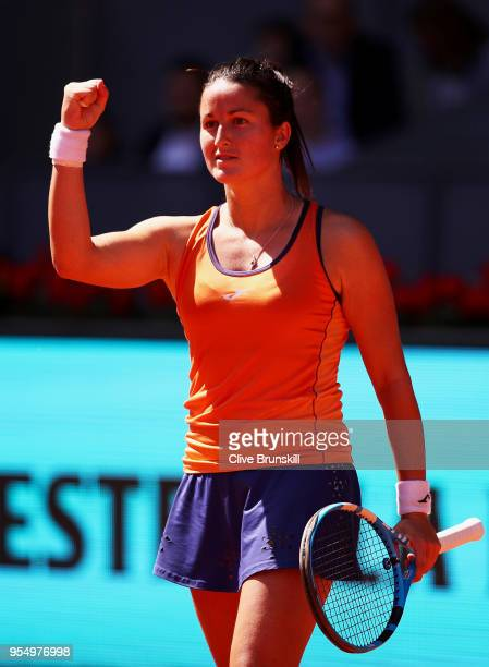 Lara Arruabarrena of Spain celebrates match point against Marta Kostyuk of the Ukraine in their first round match during day one of the Mutua Madrid...