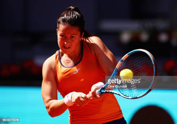 Lara Arruabarrena of Spain plays a backhand against Marta Kostyuk of the Ukraine in their first round match during day one of the Mutua Madrid Open...