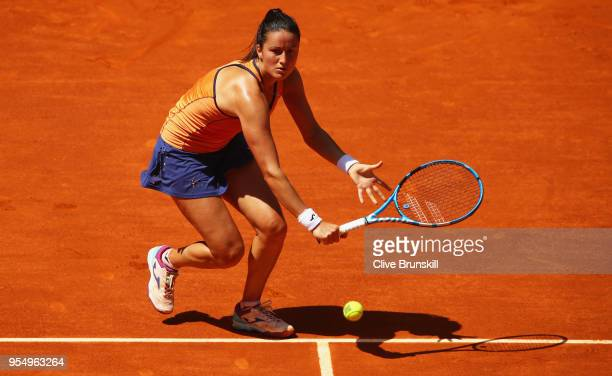 Lara Arruabarrena of Spain plays a backhand volley against Marta Kostyuk of the Ukraine in their first round match during day one of the Mutua Madrid...