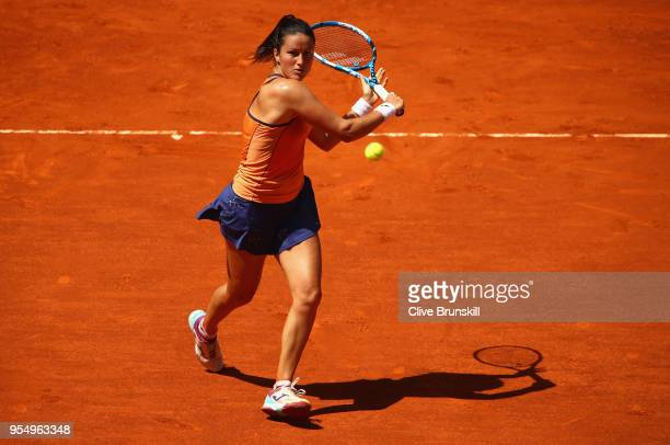 Lara Arruabarrena of Spain runs to play a backhand against Marta Kostyuk of the Ukraine in their first round match during day one of the Mutua Madrid...
