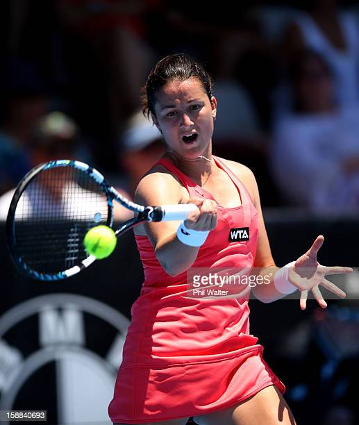 Lara ArruabarrenaVecino of Spain plays a forehand in her first round match against Yaroslava Shvedova of Kazakhstan during day two of the 2013 ASB...