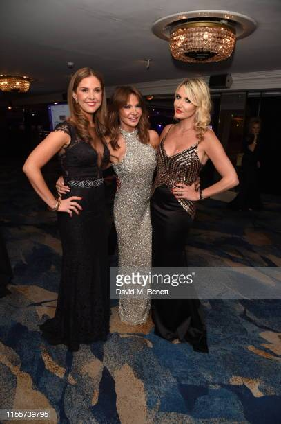 Lara Asprey Lizzie Cundy and Nancy Sorrel attend The Caudwell Children Butterfly Ball at The Grosvenor House Hotel on June 13 2019 in London England