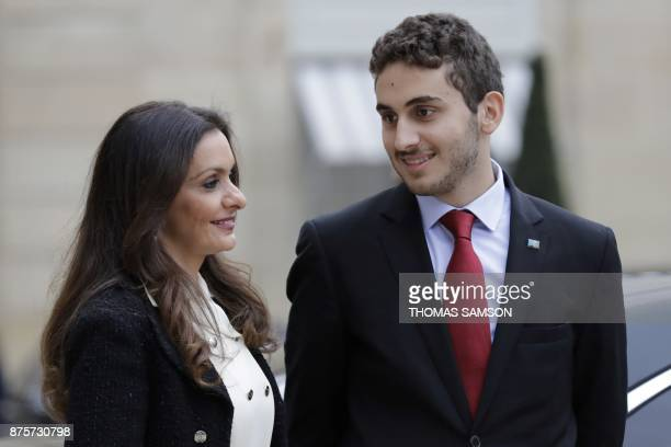 Lara Bachir ElAlzm wife of Lebanese Prime Minister and her son Houssam leave after meeting with French President at the Elysee Presidential Palace on...