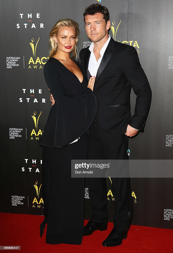 Lara Bingle and Sam Worthington arrive at the 3rd Annual AACTA Awards Ceremony at The Star on January 30, 2014 in Sydney, Australia.