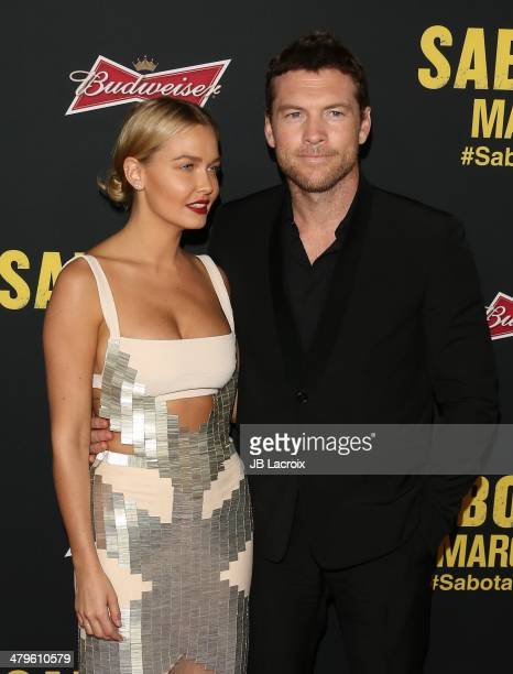 Lara Bingle and Sam Worthington attend the 'Sabotage' Los Angeles premiere held at Regal Cinemas LA Live on March 19 2014 in Los Angeles California