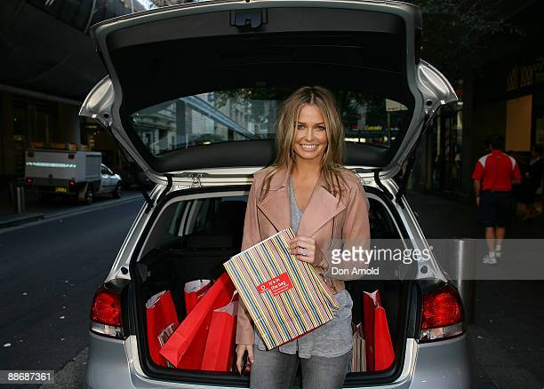 Lara Bingle poses with the new Vodafone iPhone at the Vodafone store on Pitt St on June 26 2009 in Sydney Australia