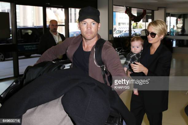 Lara Bingle Sam Worthington and their son Rocket leave Sydney on December 1 2015 in Sydney Australia