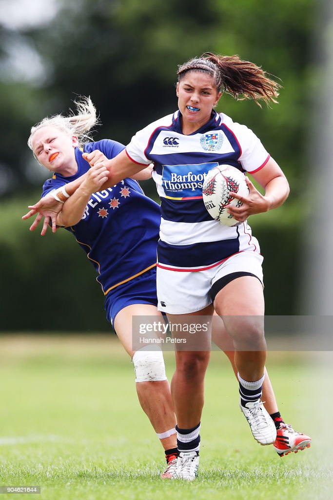 Lara Diamond-Brahne of Auckland fends off Zoey Flockton of Otago during the Bayleys National Sevens quarter final cup match between Otago and Auckland at Rotorua International Stadium on January 14, 2018 in Rotorua, New Zealand.