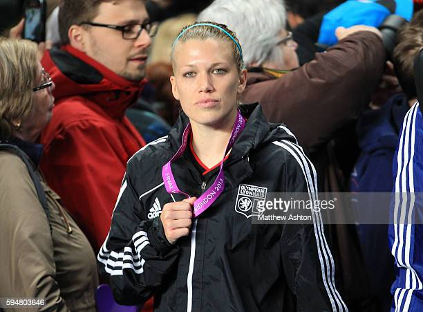 Lara Dickenmann of Olympique Lyonnais with her losers medal