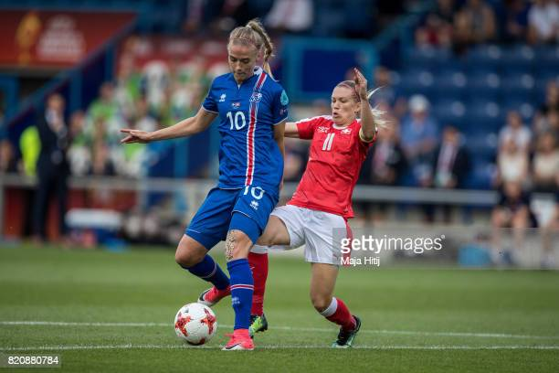 Lara Dickenmann of Switzerland and Dagny Brynjarsdottir of Iceland battle for the ball during the UEFA Women's Euro 2017 Group C match between...
