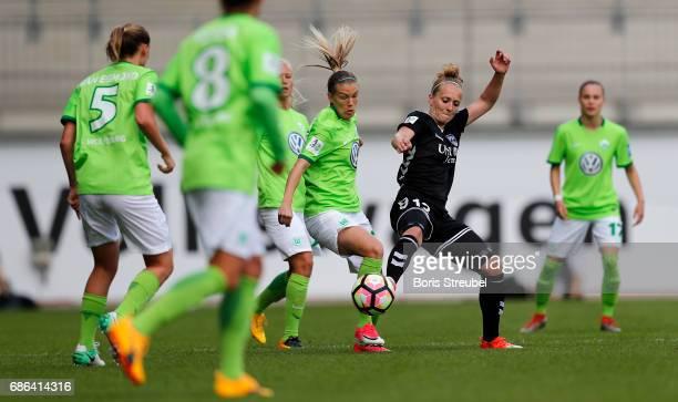 Lara Dickenmann of VfL Wolfsburg is challenged by Karoline Heinze of FF USV Jena during the Allianz Women's Bundesliga match between VfL Wolfsburg...