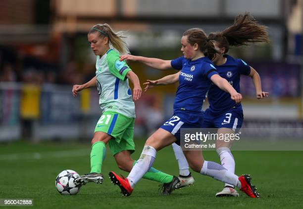 Lara Dickenmann of Wolfsburg is challenged by Erin Cuthbert of Chelsea during the UEFA Womens Champions League SemiFinal First Leg between Chelsea...