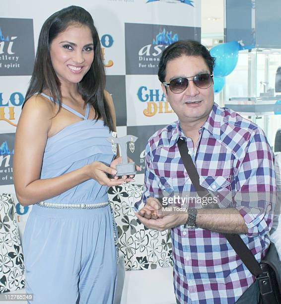 Lara Dutta and Vinay Pathak during a promotional event for their film 'Chalo Dilli' at Asmi Jewellery showroom