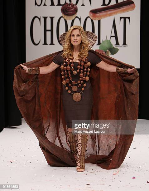 Lara Fabian displays a chocolate decorated dress during the Chocolate dress fashion show celebrating Salon Du Chocolat 15th Anniversary Opening Night...
