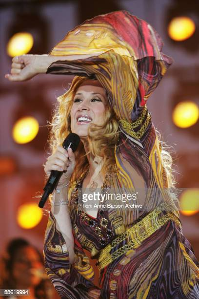 Lara Fabian performs at the France 2 Live Show ' Fete de la Musique' in the Bagatelle Gardens on June 21 in Paris France