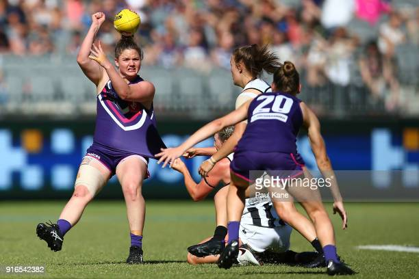Lara Filocamo of the Dockers handballs during the round two AFLW match between the Fremantle Dockers and the Collingwood Magpies at Optus Stadium on...