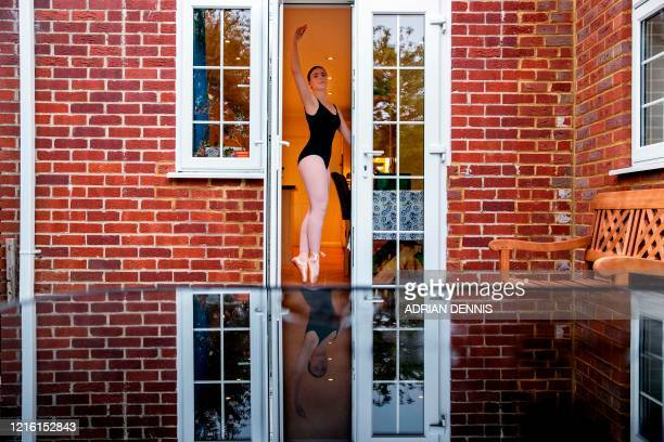 Lara Flux-Doble dances at home during an online ballet class in Hartley Wintney, a village 45 miles southwest of London on April 29, 2020 during the...